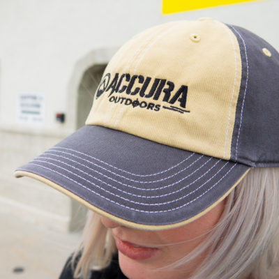 Accura bland and tan hat